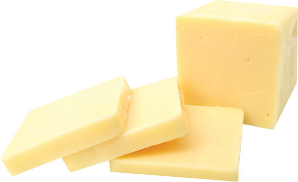 A chunk of white cheddar with slices of cheddar in front